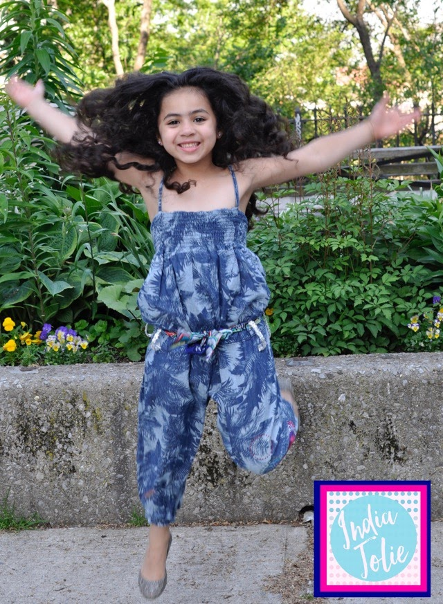 Girl jumpin in air at park with Desigual Kids blue cotton printed spaghetti strap jumper
